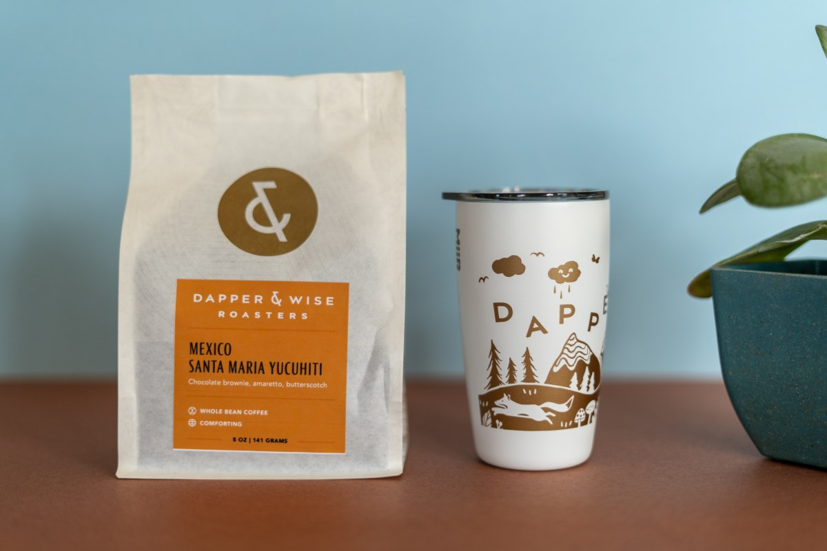 Dapper & Wise whole bean coffee and tumbler