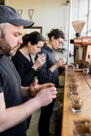 kuma crew tasting coffee