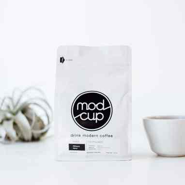 Mod Cup Ethiopia coffee packaging with plant and mug