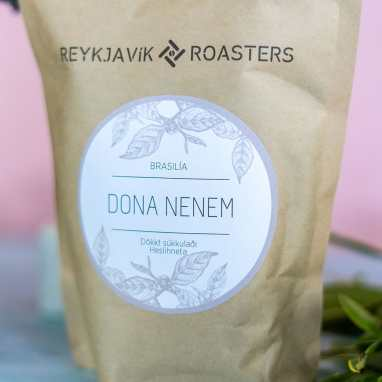 Reykjavik Roasters Dona Nenem coffee packaging with plants in the background