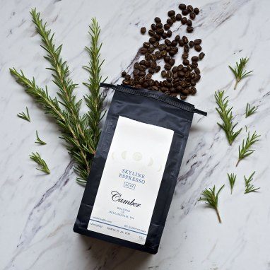 Camber coffee's Skyline Espresso coffee with rosemary plant
