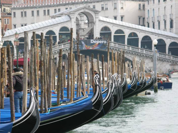 Gondolas in front of Rialto in Venice