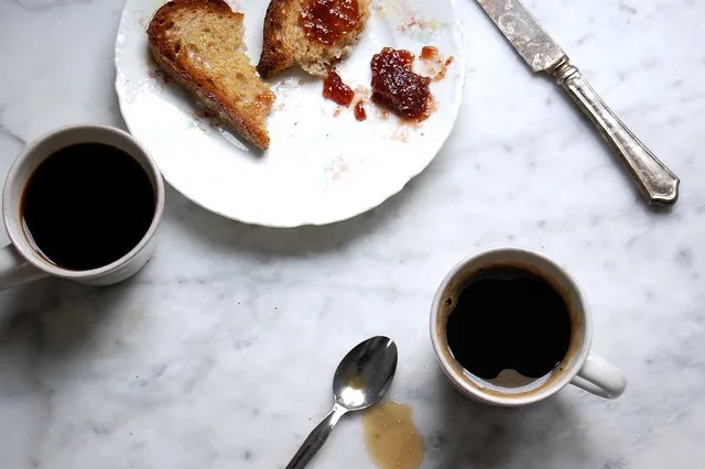cups of coffee with toast and jam