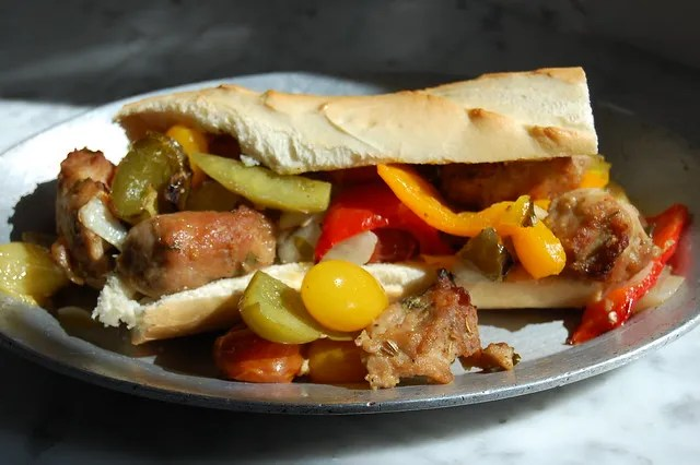 sausage peppers and onions on sub roll