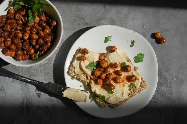 fried chickpeas in bowl with hummus toast