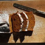sliced pumpkin bread on cutting board with knife