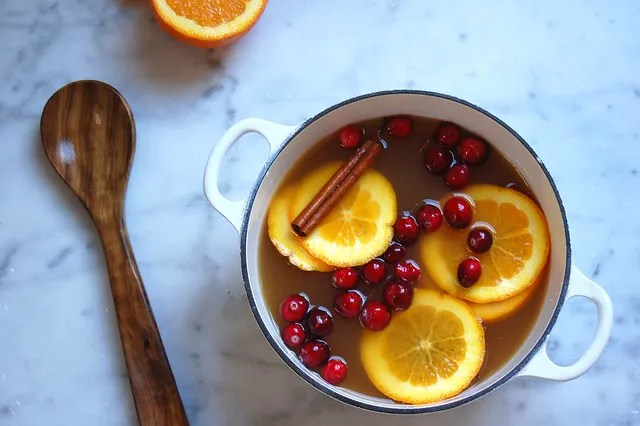 pink apple cider with cranberry and cinnamon on linen