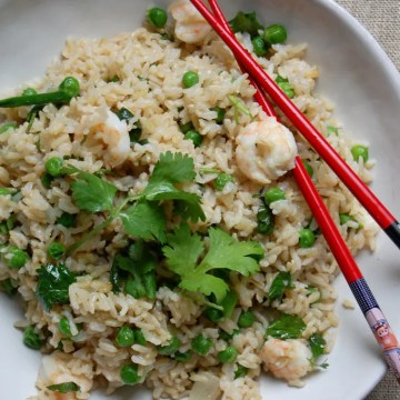 chicken shrimp fried rice with cilantro red chopsticks