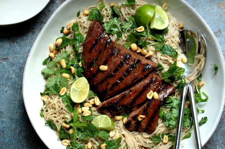 grilled flank steak on bed or rice noodles with herbs