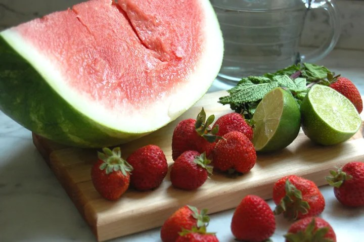 wedge of watermelon with strawberries and lime agua fresca