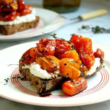 plates of tomato bruschetta with ricotta
