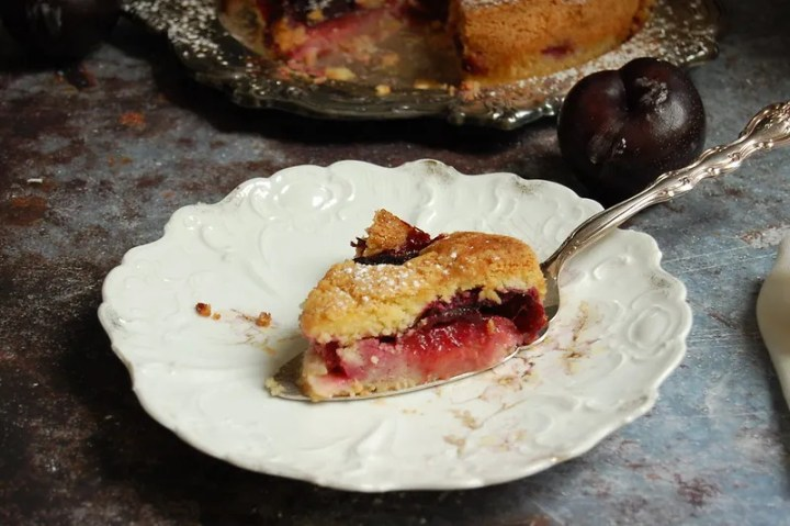 slice of plum cake torte on white plate