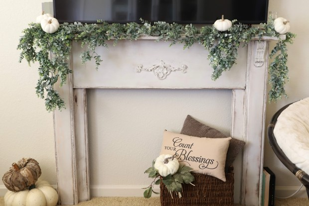restored 1900s mantel. Fall mantels. A pretty solution to incorporating a TV into your living room design