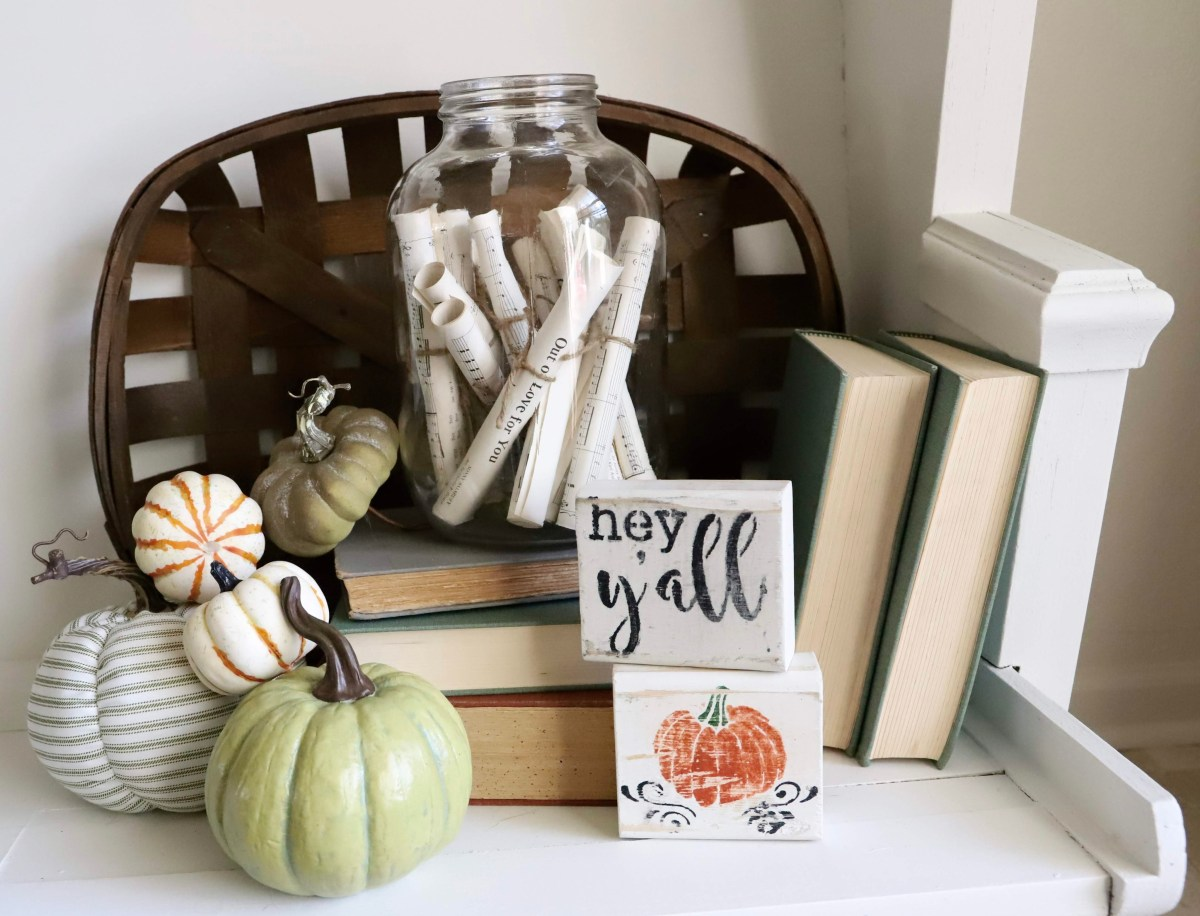 farmhouse fall centerpiece ideas, using old books, hymnal crafts, white and green pumpkins, and chippy paint signs
