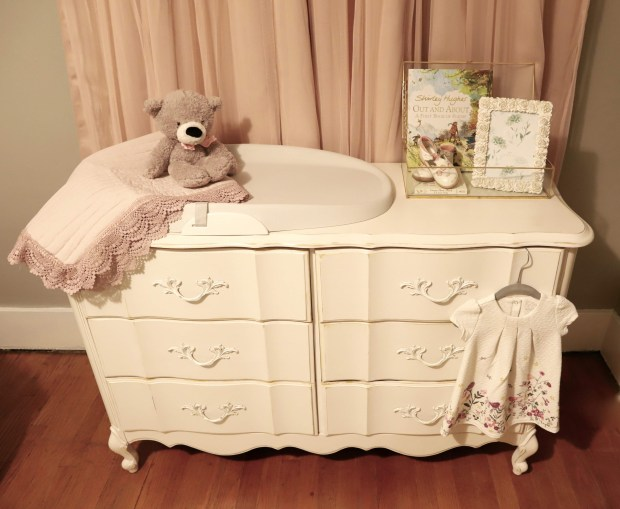 How to refinish a dresser into a baby girls nursery changing table. Beautiful vintage furniture with dual functionality that looks stunning in any nursery.