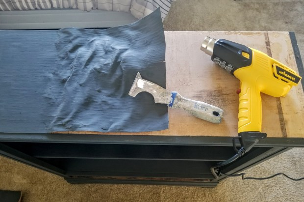 How to remove an old wood venner by using a heat gun and putty knife.