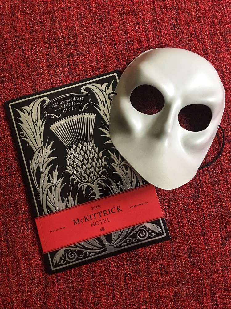 McKittrick-mask-and-book