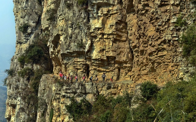Five-hour journey through the mountains on a 1ft-wide path to the most remote school in the world, Gulu, China
