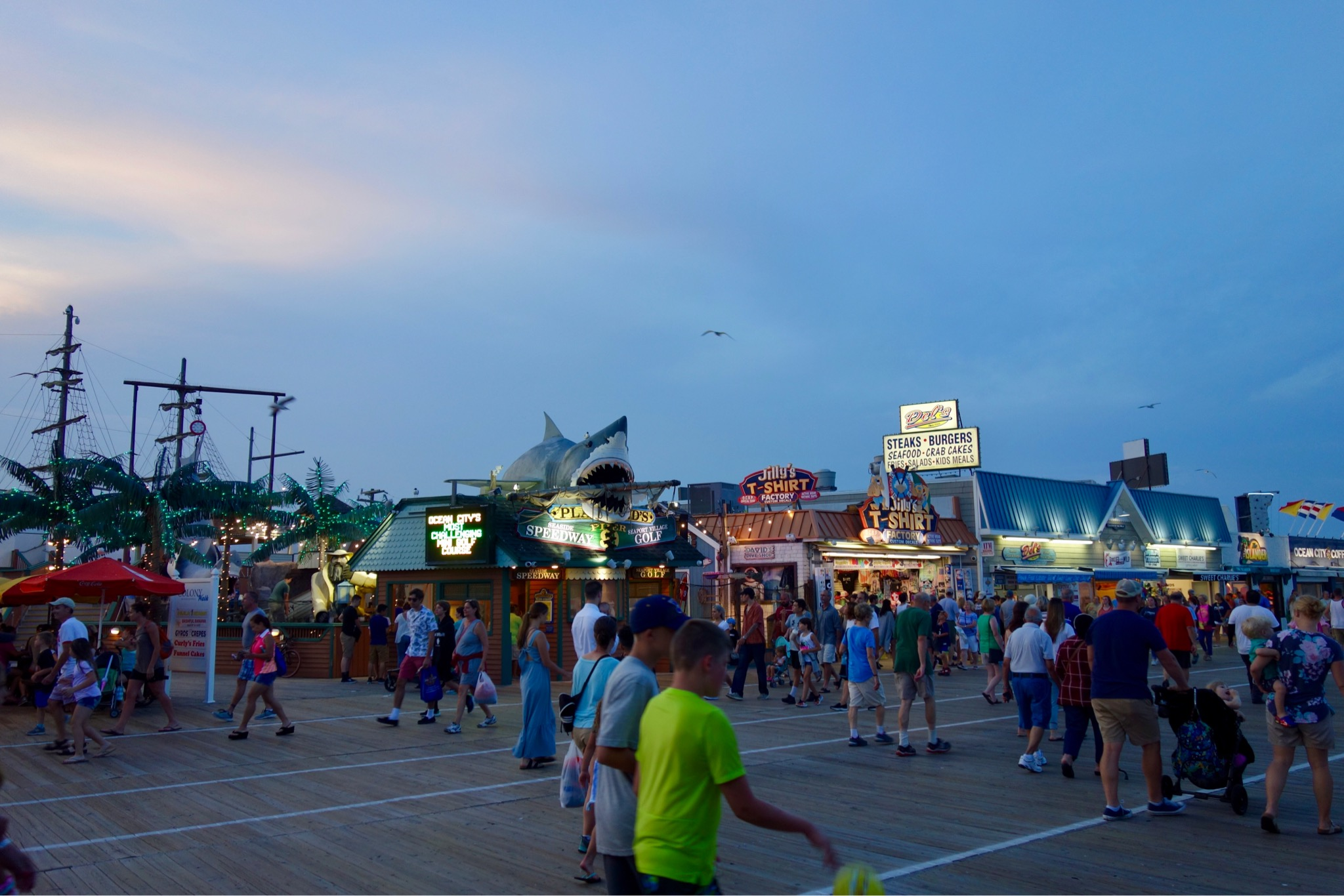 Busy amusements and attractions on Ocean City promenade