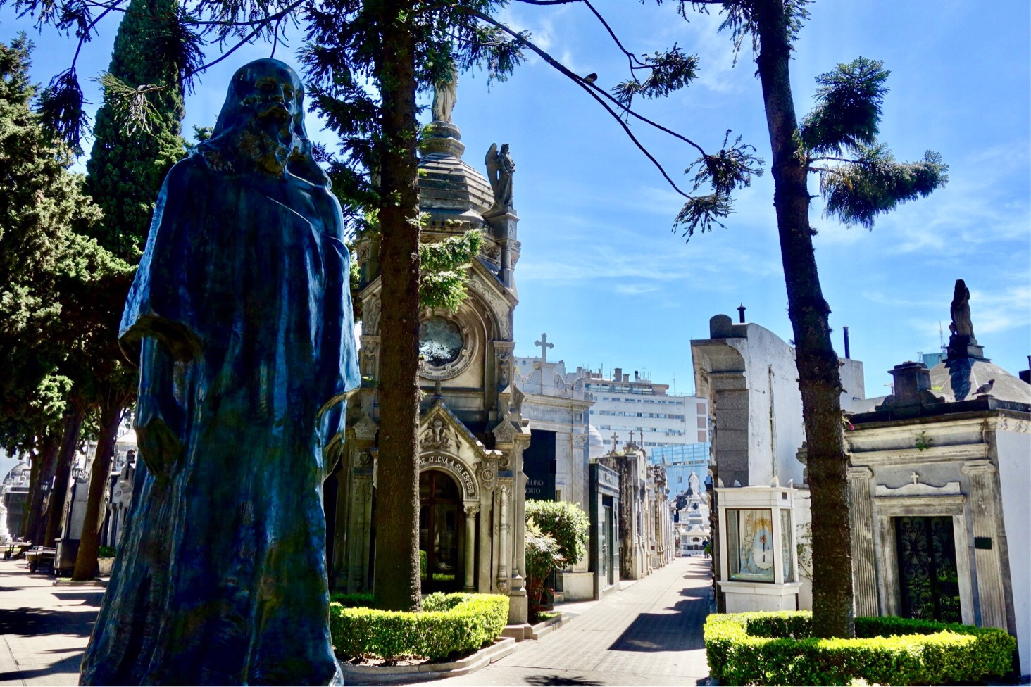 Tall Christ statue in black marble in Recoletta Cemetery, Buenos Aires