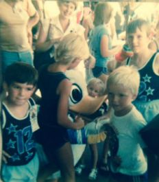"My brother and I in snappy matching tank tops having a ""not so personal"" character experience with Donald Duck sometime in the 70s."