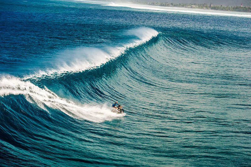 Robbie Maddison Riding a Wave in Tahiti on a Motorcycle