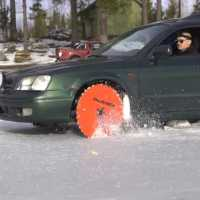 Driving On a Frozen Finnish Lake With Giant Table Saw Blades as Wheels