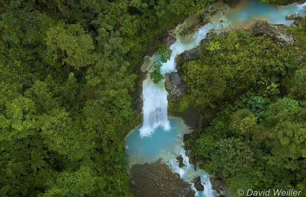 Turquoise Blue Waterfall in the Rainforest of Costa Rica