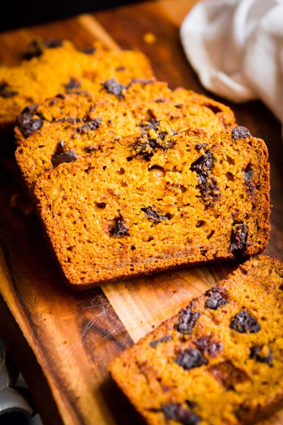 Chocolate Pumpkin Bread -- dark chocolate chunks and a shot of strong-brewed coffee take this tried and true pumpkin bread recipe to the next level... Grab a cup of coffee and savor a slice! | via @unsophisticook on unsophisticook.com