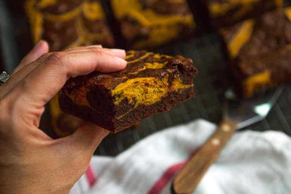 Pumpkin Swirl Brownies -- a pumpkin cheesecake mixture swirled into a rich and fudgy brownies batter makes these amazing brownies extra decadent... You'll definitely want a tall glass of milk with them!   via @unsophisticook on unsophisticook.com