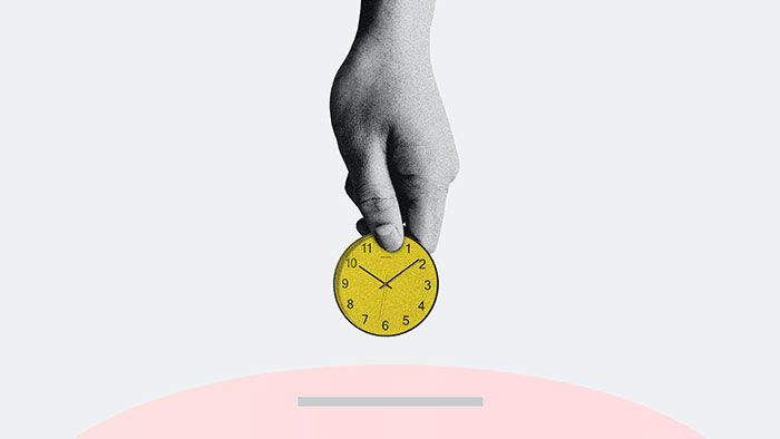 hand-placing-time-into-moneybox