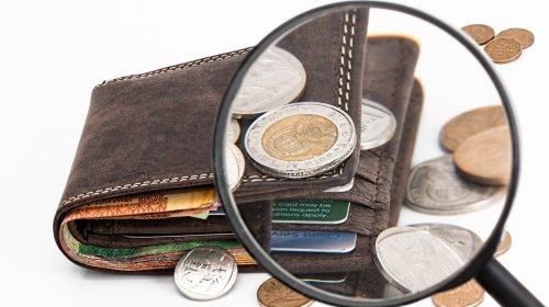 wallet with money around it