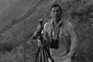 Cesar Bollatty Bedregal a Peruvian bird guide with his telescope