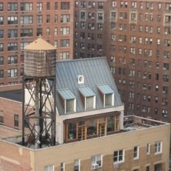 10 Quirky Houses On Top of Apartment Buildings in NYC: Beach House, Lighthouse, Ski Chalet, Suburban Spread