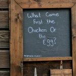 """What came first the chicken or the egg"" sign in front of a stall in Ardenwood Historic Farm, Fremont"