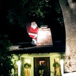 Santa on the roof, on Christmas Tree Lane in Palo Alto