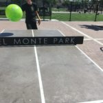 Playing ping pong with a beach ball, Del Monte Park, San Jose