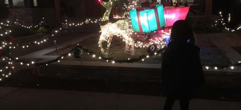 Kid admiring Rudolph on Eucalyptus Street, San Carlos