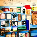 The wall with authors and books artifacts at Hicklebee's, San Jose.