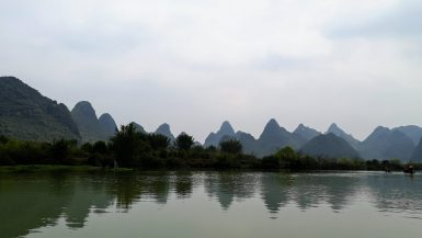 Yangshuo river with view of rolling hills
