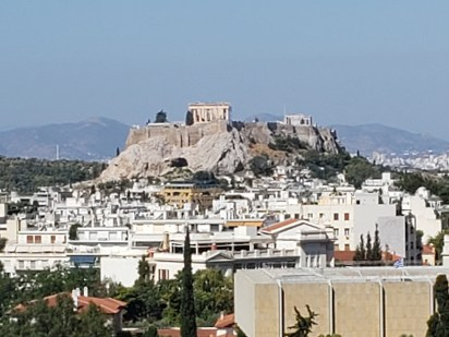 Acropolis towers over Athens on a hilltop