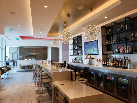 Airport lounges offer fully stocked bars and quiet workplaces