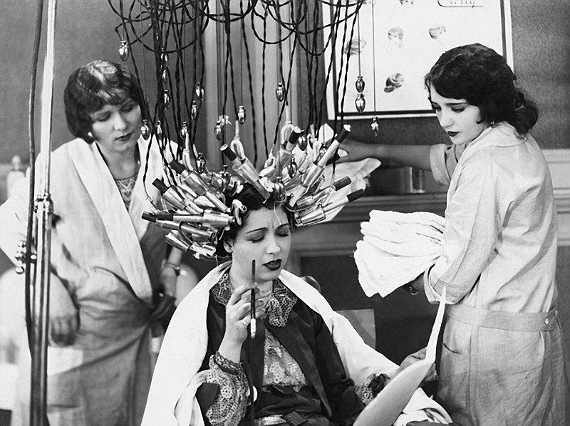 Another device for permanent hair waving. Women had to sit with such a thing on the head for hours.