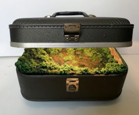 """Traveling Landscape, Grey Samsonite,"" vintage train case, resin, artificial foliage, soil, water, water pump, and fluorescent light, 13 x 9 x 9 inches. All images © Kathleen Vance"