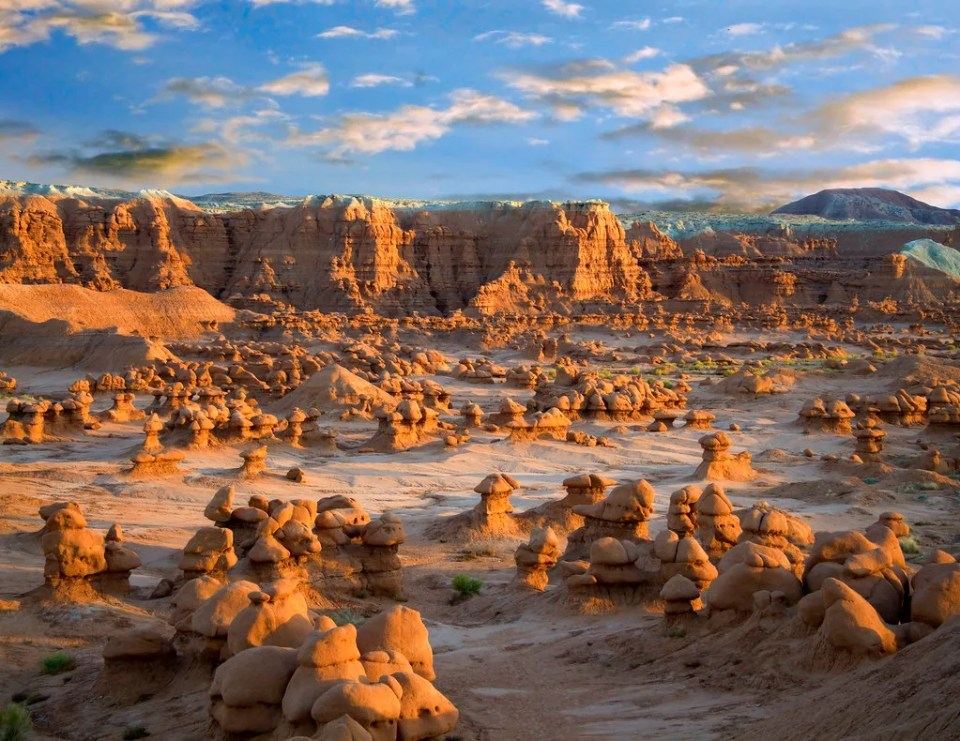 Summer clouds at sunset over Goblin Valley State Park in the San Rafael Swell desert of southern Utah USA