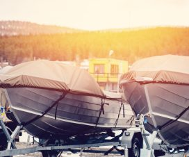 Storage vessels, boats, ships. Boats are protected by a tent from rain and winter. Stock.