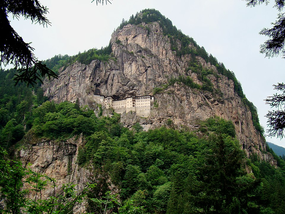 The monastery is on a ledge in a steep cliff
