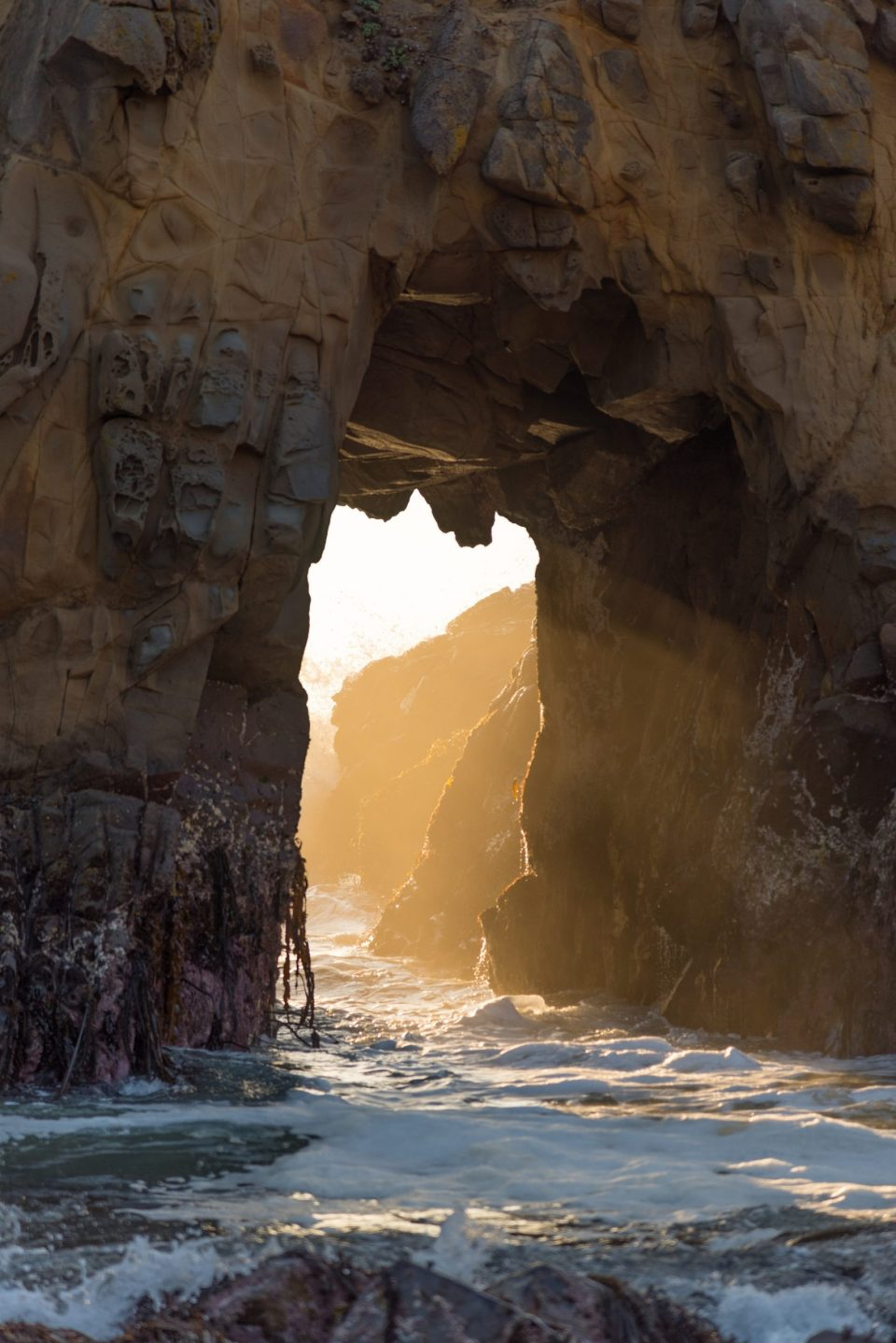 Waiting for the sun to set at Pfeiffer beach in Big Sur, the golden hour illuminated this opening and created a magical setting.