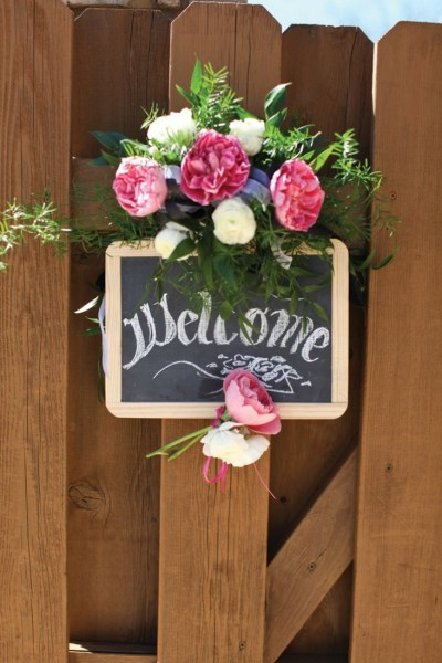 Chalk welcome sign with flowers