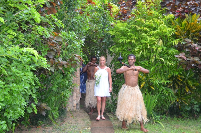 Fiji wedding guards and the bride make their entrance